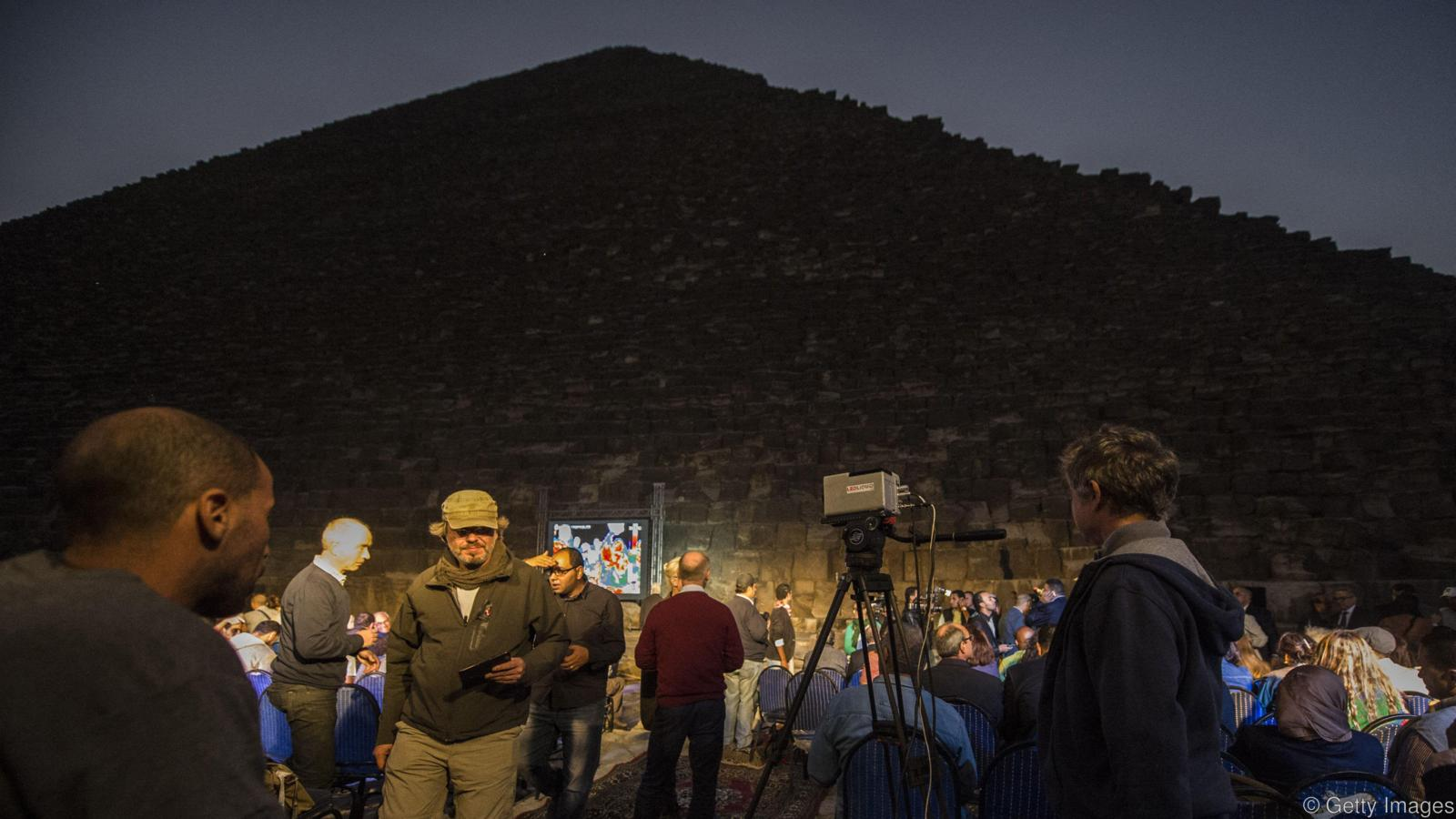 People gather near the great pyramid of Khufu (Cheops) in Giza on the outskirts of Cairo on November 9, 2015, during an infrared thermography experiment to map out the temperature of the walls. AFP PHOTO / KHALED DESOUKI (Photo credit should read KHALED DESOUKI/AFP/Getty Images)