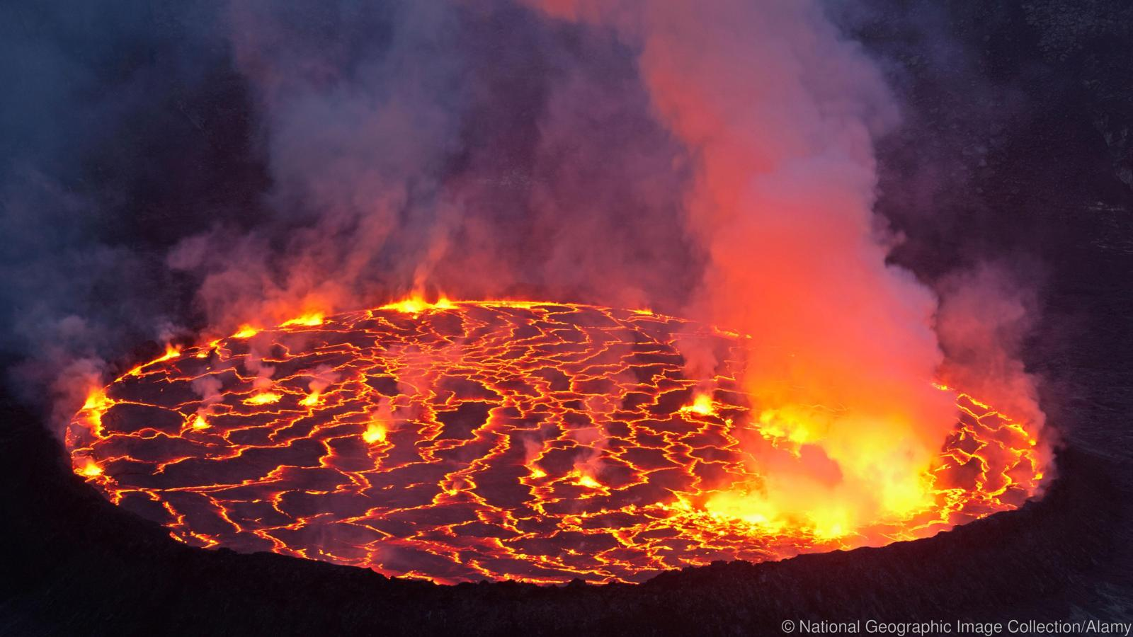 Molten rock cools and forms plates on the surface of a lava lake.