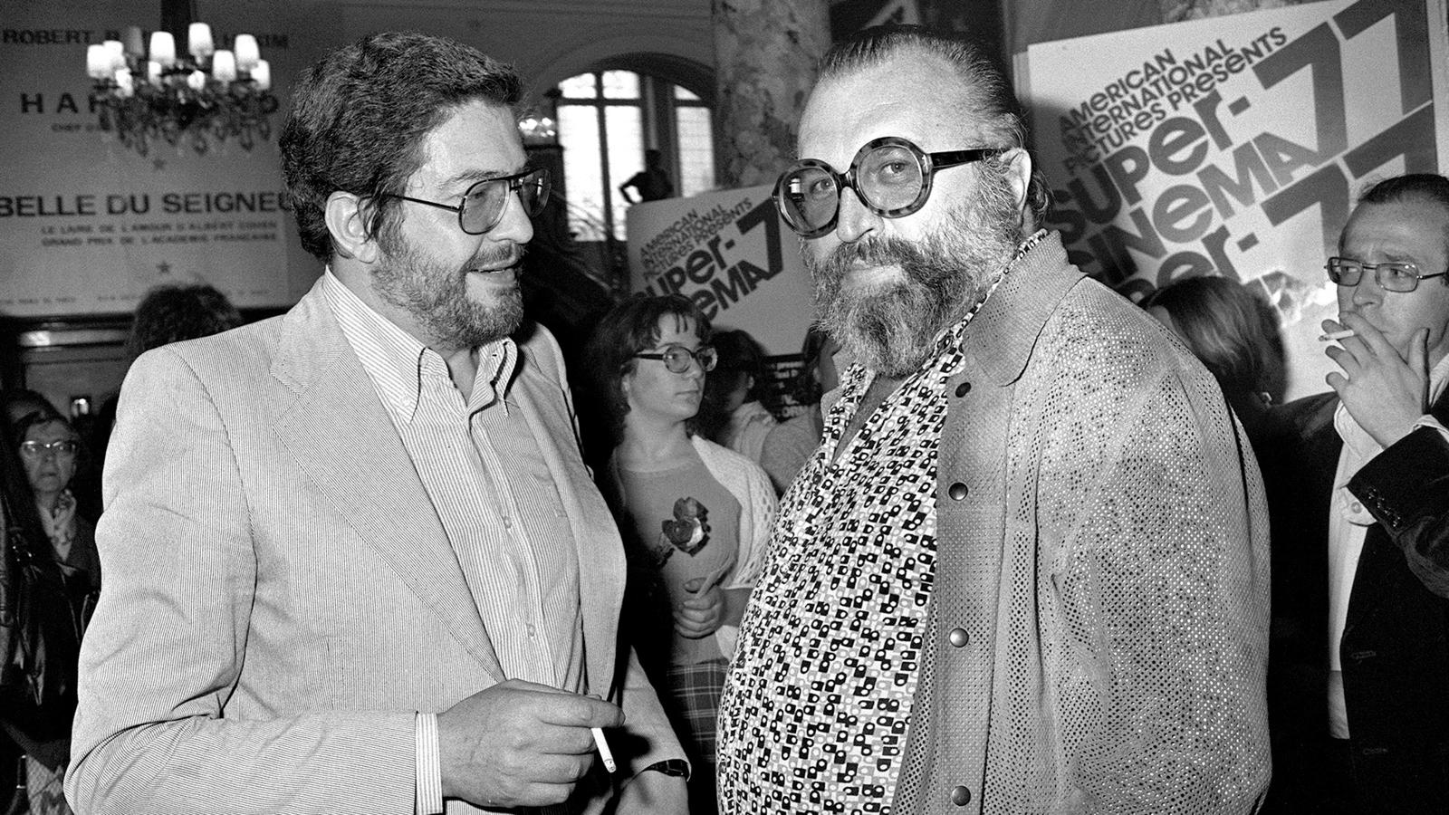 Italian movies makers, Ettore Scola (L) and Sergio Leone, speak on May 20, 1977 during the 30th International Fillm Festival in Cannes. AFP PHOTO PATRICK HERTZOG (Photo credit should read /AFP/Getty Images)